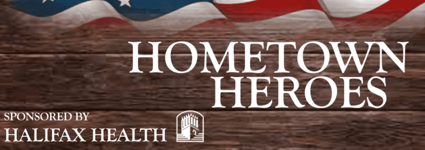 Hometown Heroes sponsored by Halifax Health with American Flag and wood background